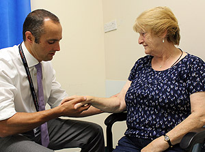 A consultant with a patient