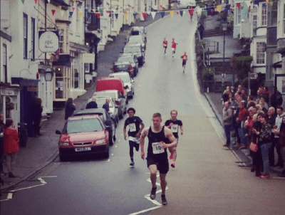 Photo of The Modbury Mile - people running through the centre of Modbury