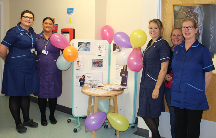 Maternity team with vaccination stand