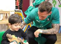 Photo of Argyle player visiting children's wards