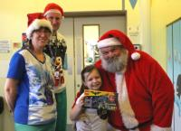 Santa delivering lego from Fairy Bricks to patients in Children's Theatres