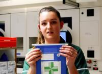 Pharmacy Technician, Chloe Cates, demonstrates paper pharmacy bags